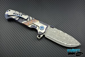 custom Andre De Villiers Ronin knife, mokuti frame inlay and backspacer, damascus blade steel, blue anodized hardware