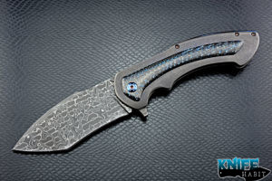 custom rick barrett full size fallout knife, stainless damascus blade steel, tumbled stonewashed titanium frame, blue mylar light strike carbon fiber inlays, timascus clip, blue anodized hardware