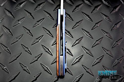 custom jason clark hybrid wharnciffe knife, mammoth ivory scale, blue anodized titanium, cts-xhp blade steel, mill timascus clip