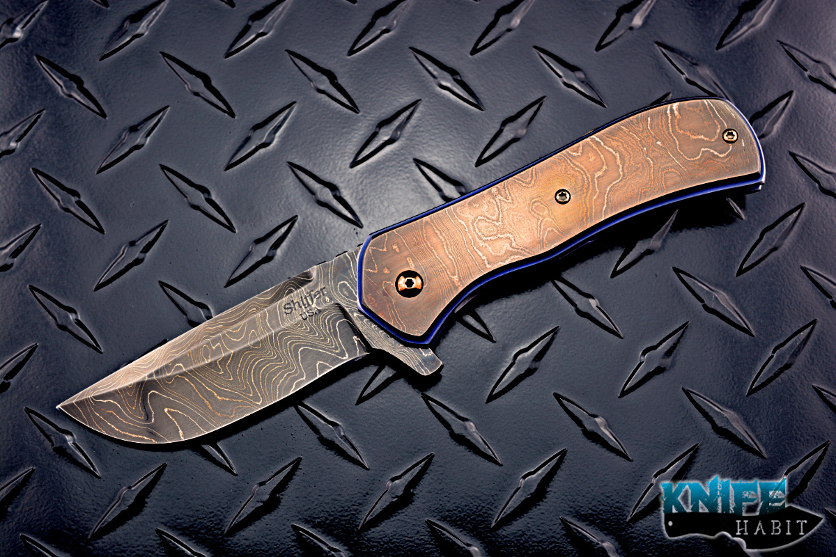 custom doc shiffer recon knife, heat colored bronzed damascus blade, antique damascus overlay, blue anodized titanium liners, zirconium pocket clip